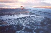 A photo of snow-covered Whitehorse, Yukon on October 21, 2000. Taken from a Canada 3000 jet.